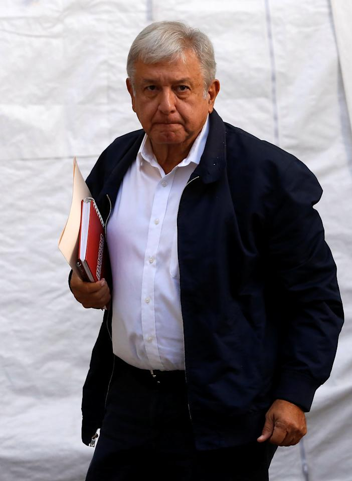 Mexico's president-elect Andres Manuel Lopez Obrador arrives to his campaign headquarters for a news conference in Mexico City, Mexico July 22, 2018. REUTERS/Ginnette Riquelme