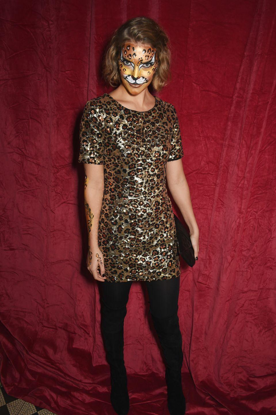 """<p>To get in touch with your wild side, throw on an animal print dress or shirt and then turn your face into a work of art with a face paint kit. </p><p><strong>What You'll Need:</strong> <a href=""""https://www.amazon.com/POPYOUNG-Dresses-X-Large-Spotted-Pattern/dp/B07ZS9FGMW?tag=syn-yahoo-20&ascsubtag=%5Bartid%7C10070.g.28166042%5Bsrc%7Cyahoo-us"""" rel=""""nofollow noopener"""" target=""""_blank"""" data-ylk=""""slk:leopard-print dress"""" class=""""link rapid-noclick-resp"""">leopard-print dress</a> and <a href=""""https://www.amazon.com/Hanes-Reflections-Womens-Curves-Blackout/dp/B07DLRWBM2?tag=syn-yahoo-20&ascsubtag=%5Bartid%7C10070.g.28166042%5Bsrc%7Cyahoo-us"""" rel=""""nofollow noopener"""" target=""""_blank"""" data-ylk=""""slk:black tights"""" class=""""link rapid-noclick-resp"""">black tights</a></p>"""
