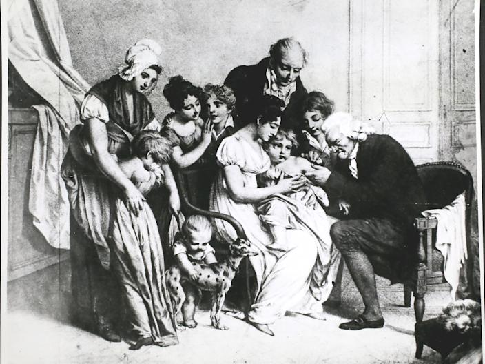 Edward Jenner innoculates a child against smallpox in 1796.
