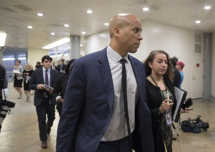 Democratic Senator from New Jersey Cory Booker (L) walks near the Senate subway on Capitol Hill in Washington, DC, USA, 10 May 2017. The Senate convenes the day after US President Donald J. Trump fired James Comey as Director of the FBI. Senate Democrats strongly criticized the decision and are calling for the appointment of a special prosecutor to take over the inquiry into Russia's interference in the US presidential election of 2016. (Photo: Michael Reynolds/EPA)