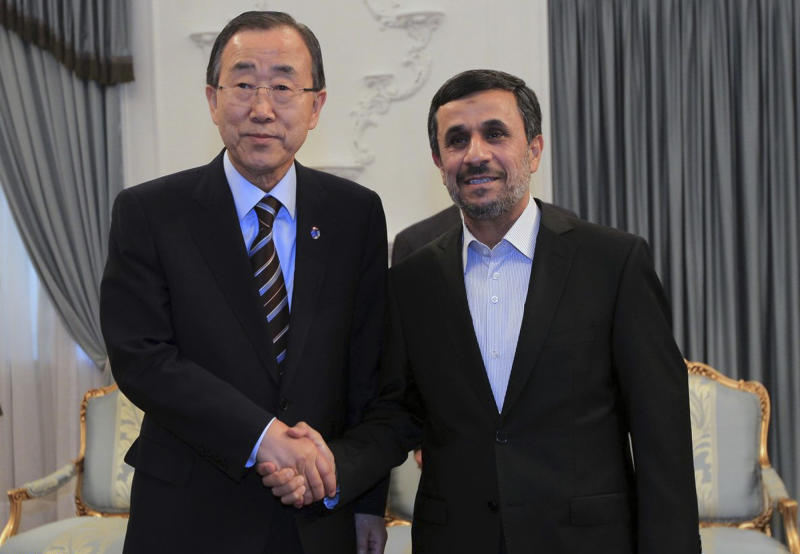 In this photo released by the official website of the Iranian Presidency Office, Iranian President Mahmoud Ahmadinejad, right, shakes hands with U.N. Secretary-General Ban Ki-Moon, at the start of their meeting in Tehran, Iran, Wednesday, Aug. 29, 2012. (AP Photo/Presidency Office, Mohsen Rafinejad)