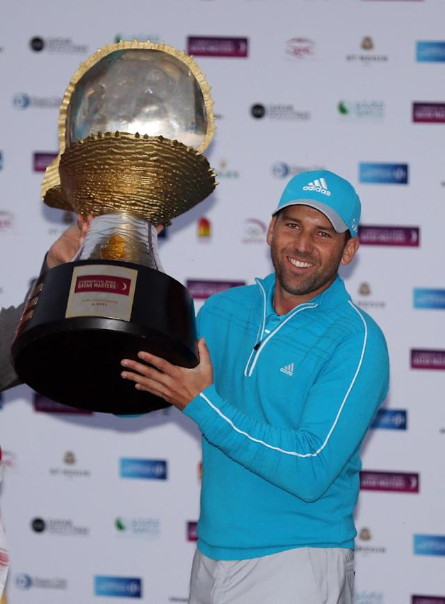 Sergio Garcia of Spain holds up the winner's trophy after the final round of the Commercial Bank Qatar Masters at the Doha Golf Club in Doha, Qatar, Saturday, Jan. 25, 2014. Garcia won the Qatar Masters on Saturday after he birdied the third extra hole to beat Finland's Mikko Ilonen in a playoff. (AP Photo/Osama Faisal)