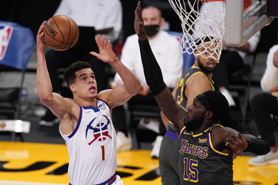 Denver Nuggets forward Michael Porter Jr., left, shoots as Los Angeles Lakers center Montrezl Harrell defends during the first half of an NBA basketball game Monday, May 3, 2021, in Los Angeles. (AP Photo/Mark J. Terrill)