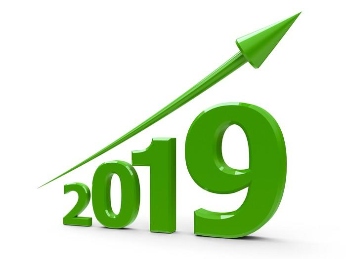 Green arrow trending up over the numerals 2019
