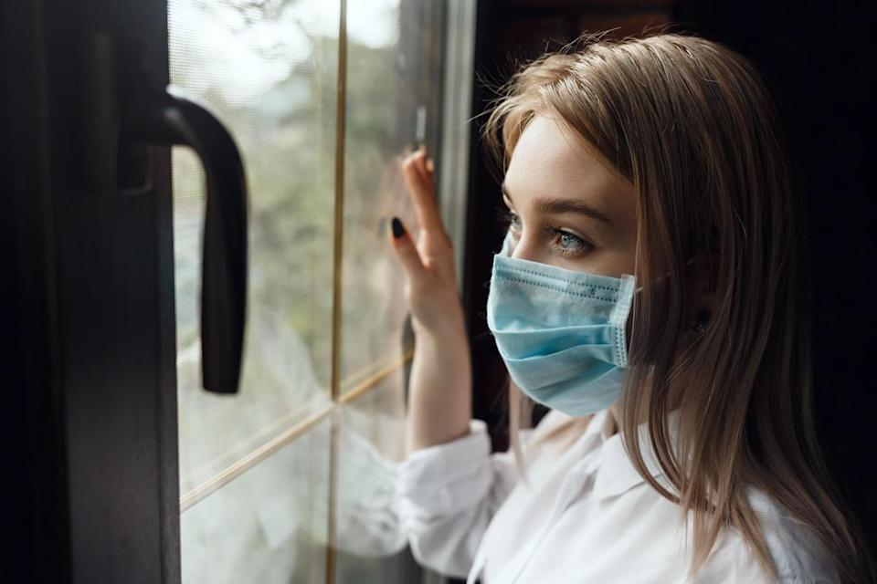 Woman home isolation quarantine wearing face mask