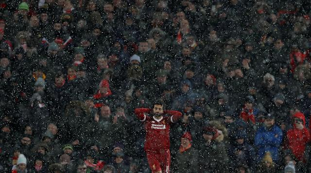 "Soccer Football - Premier League - Liverpool vs Watford - Anfield, Liverpool, Britain - March 17, 2018 Liverpool's Mohamed Salah reacts as the snow falls Action Images via Reuters/Lee Smith EDITORIAL USE ONLY. No use with unauthorized audio, video, data, fixture lists, club/league logos or ""live"" services. Online in-match use limited to 75 images, no video emulation. No use in betting, games or single club/league/player publications. Please contact your account representative for further details."