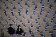 Spectators watch Austria's Dominic Thiem playing Spain's Pablo Andujar during their first round match of the French Open tennis tournament at the Roland Garros stadium Sunday, May 30, 2021 in Paris. (AP Photo/Christophe Ena)
