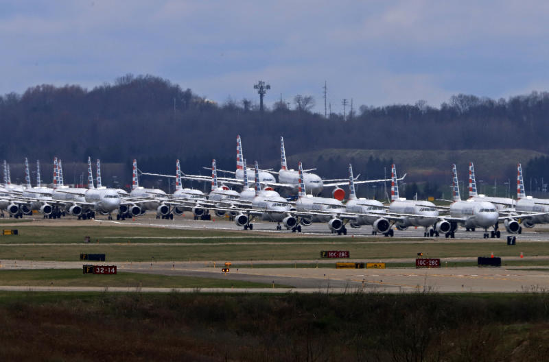 Some of the 88 American Airlines planes stored at Pittsburgh International Airport sit idle on a closed runway in Imperial, Pa., on Tuesday, March 31, 2020. As airlines cut more service, due to the COVID-19 pandemic, Pittsburgh International Airport has closed one of its four runways to shelter in place 96 planes, mostly from American Airlines, as of Monday, March 30, 2020. The airport has the capacity to store 140 planes.(AP Photo/Gene J. Puskar)