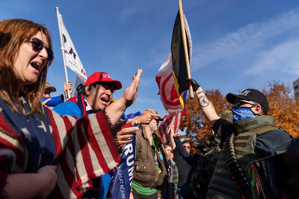 Trump supporters, at left, demonstrating the election results are confronted by counterprotesters at the State Capitol in Lansing, Mich., on Nov. 7, 2020.