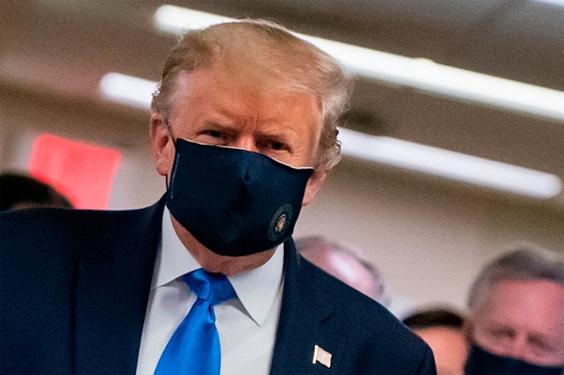 Donald Trump sports a mask on a visit to Walter Reed hospital in Bethesda, Maryland: AFP via Getty Images