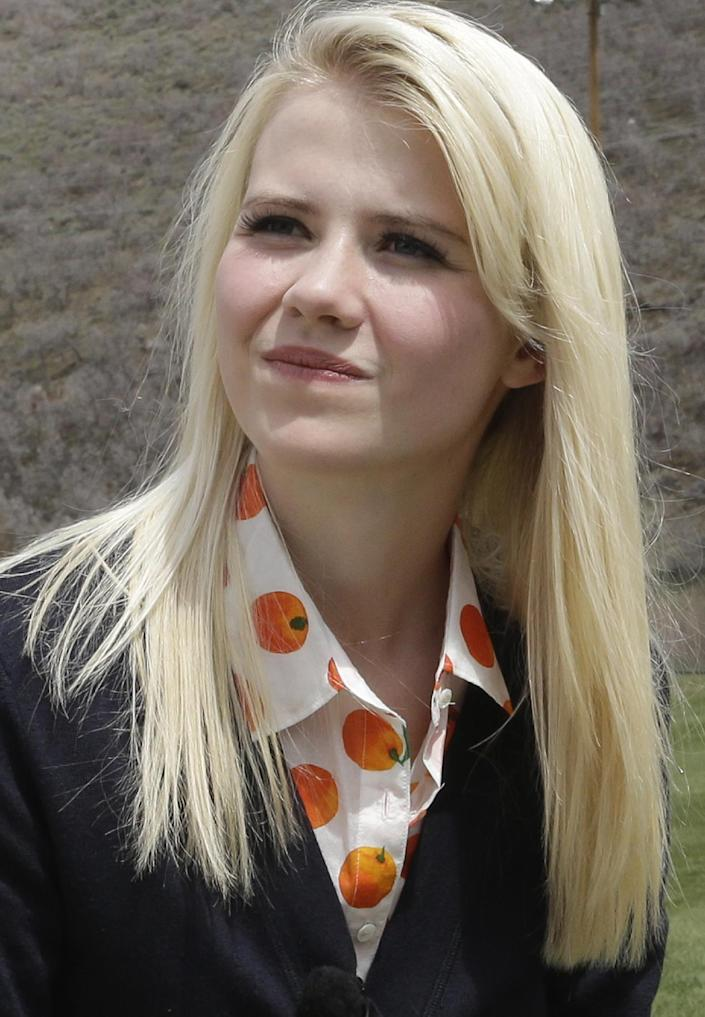 "FILE - In this Tuesday, May 7, 2013 file photo, Elizabeth Smart prepares for an interview, in Park City, Utah. Smart said she's elated to hear about three Cleveland women who escaped Monday, May 6, after they disappeared a decade ago. ""First of all, I'd make sure these young women know that nothing that happened to them is their fault,"" Smart recently told People magazine. Smart was kidnapped from her bedroom in Salt Lake City when she was 14. She was freed nine months later when she was found walking with her captor on a suburban street in March 2003. (AP Photo/Rick Bowmer, File)"