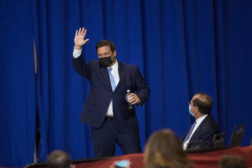 Florida Gov. Ron DeSantis acknowledeges the crowd at the Caloosa Sound Convention Center and Amphitheater in downtown Fort Myers on Friday, October 16, 2020.