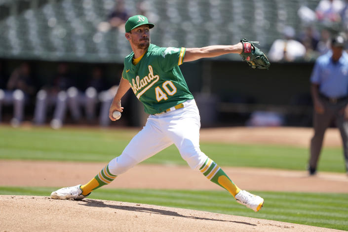Oakland Athletics starting pitcher Chris Bassitt (40) throws against the Cleveland Indians during the first inning of a baseball game Sunday, July 18, 2021, in Oakland, Calif. (AP Photo/Tony Avelar)