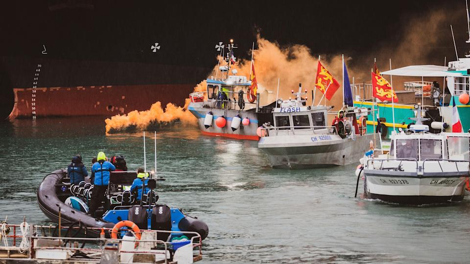 <p>Fishing vessels at sea off the coast of Jersey on Thursday</p> (AP)