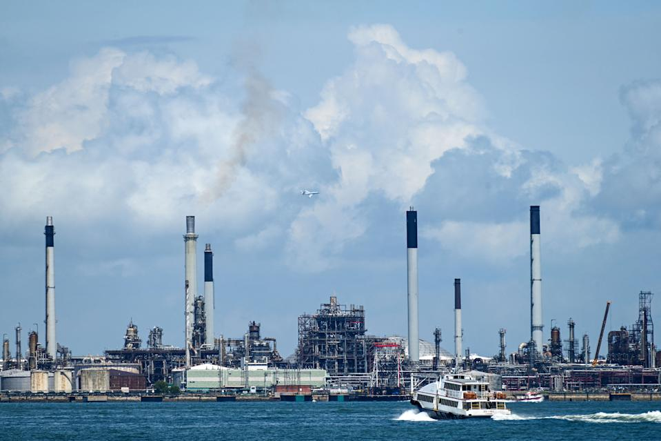 This photograph taken on June 14, 2021 shows a general view of the Shell petroleum refinery off Bukom island in Singapore. - A financial exchange offering carbon credits and investments in conservation projects is set to launch in Singapore, but it may struggle to convince sceptics of the value of controversial carbon offsets.  - TO GO WITH Singapore-market-climate, FOCUS by Martin Abbugao and Sam Reeves (Photo by Roslan RAHMAN / AFP) / TO GO WITH Singapore-market-climate, FOCUS by Martin Abbugao and Sam Reeves (Photo by ROSLAN RAHMAN/AFP via Getty Images)