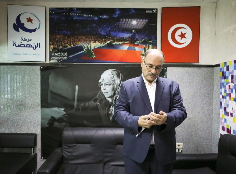 Riadh Chaibi, political advisor of Parliament Speaker Rached Ghannouchi, attends an interview with Reuters at moderate Islamist Ennahda party's headquarters in Tunis