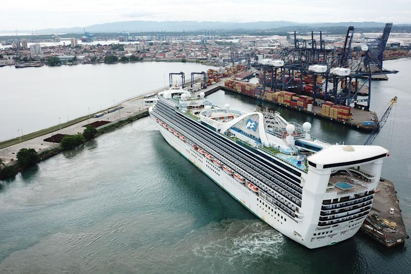 "Aerial view of the ""Caribbean Princess"" cruise docked at the port of Colon, in Panama, on May 28, 2020. - About 25 Panamanians crew members from different cruise ships that were stranded all over the world due to the covid-19 pandemic, arrived on Thursday on the ""Caribbean Princess"" cruise after been at sea for more than 60 days in some cases. (Photo by Ivan PISARENKO / AFP) (Photo by IVAN PISARENKO/AFP via Getty Images)"