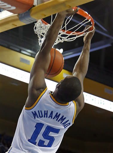 UCLA forward Shabazz Muhammad slam dunks three of his game-high 21 points against Oregon State in the second half of an NCAA men's basketball game in Los Angeles Thursday, Jan. 17, 2013. UCLA won 74-64. (AP Photo/Reed Saxon)