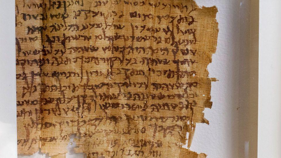 Undercover Israeli officers foiled an attempt by two Palestinian men to sell an ancient, valuable papyrus document on the black market. The document contains 15 lines of Hebrew characters of a type also used in the Dead Sea Scrolls, ancient holy books and apocalyptic treatises thought to have been collected by an ascetic Jewish sect two millennia ago. Photo: AP/Sebastian Scheiner