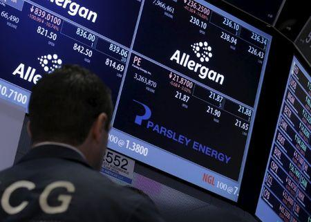 A trader works at the post that trades Parsley Energy Inc. and  Allergan Plc., on the floor of the NYSE