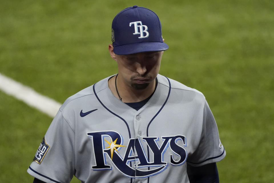 Tampa Bay Rays starting pitcher Blake Snell leaves the game against the Los Angeles Dodgers during the sixth inning in Game 6 of the baseball World Series Tuesday, Oct. 27, 2020, in Arlington, Texas. (AP Photo/Tony Gutierrez)
