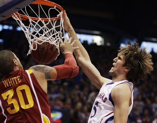 Kansas center Jeff Withey (5) dunks while covered by Iowa State forward Royce White (30) during the first half of an NCAA college basketball game in Lawrence, Kan., Saturday, Jan. 14, 2012. (AP Photo/Orlin Wagner)