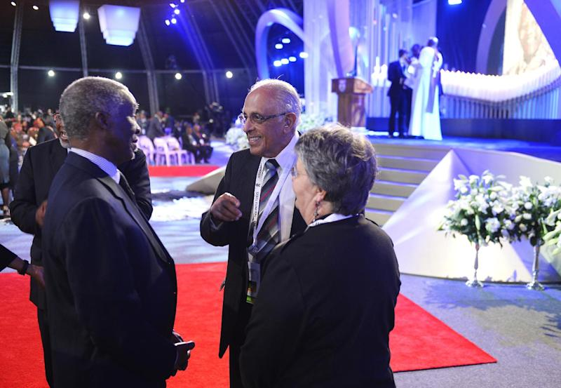 Anti-apartheid activist and close friend of Nelson Mandela, Ahmed Kathrada, right, speaks with Former South African President Thabo Mbeki as they arrive for the funeral service for former South African president Nelson Mandela in Qunu, South Africa, Sunday, December 15, 2013. (AP Photo/Odd Andersen, Pool)