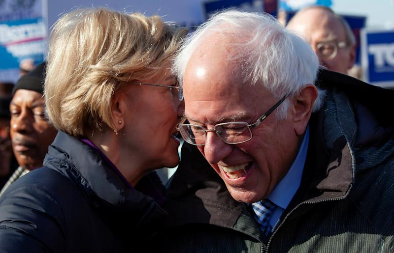 Democratic U.S. presidential candidate Sen. Elizabeth Warren laughs with fellow Democratic U.S. presidential candidate Sen. Bernie Sanders during the Martin Luther King Jr. (MLK) Day festivities in Columbia, South Carolina, U.S., January 20, 2020. REUTERS/Sam Wolfe TPX IMAGES OF THE DAY - RC2WJE9R8497