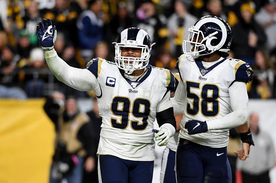 Aaron Donald #99 of the Los Angeles Rams celebrates with Cory Littleton #58