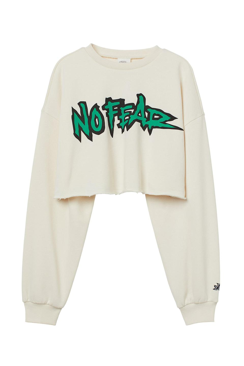 """<p>Paired with a white cropped top underneath and loose pants, this <span>No Fear x H&amp;M Short Printed Sweatshirt</span> ($18) gives you the effortless '90s skater look you're coveting. Plus, when you wear a sweatshirt that says """"No Fear,"""" it might just inspire you to be a little more fearless.</p>"""
