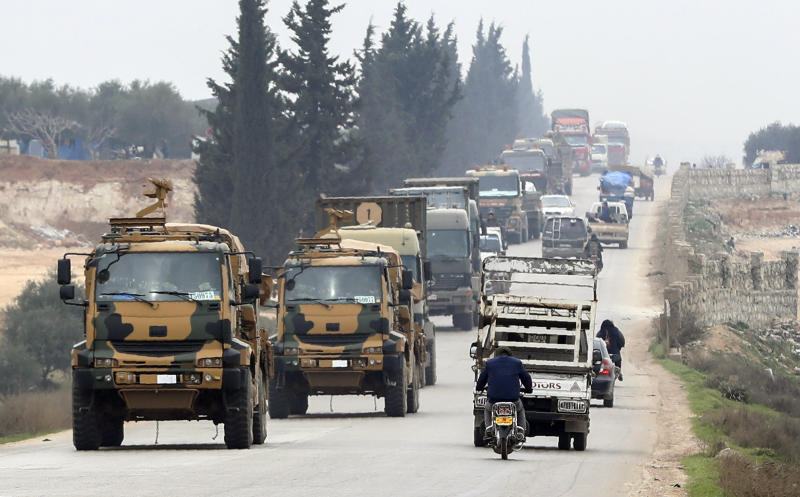 A Turkish military convoy drive in the east of Idlib, Syria, Friday, Feb. 28, 2020. NATO envoys were holding emergency talks Friday at the request of Turkey following the killing of 33 Turkish soldiers in northeast Syria, as scores of migrants gathered at Turkey's border with Greece seeking entry into Europe.(AP Photo)