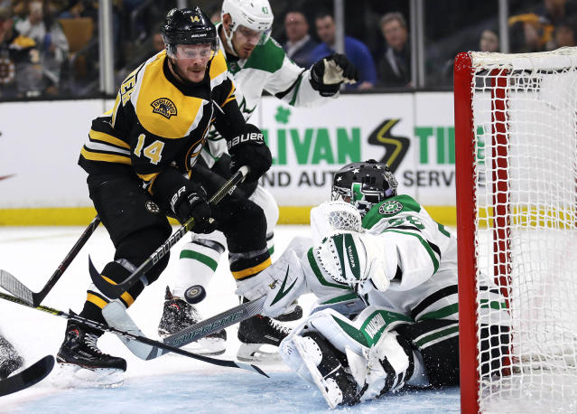 Dallas Stars goaltender Anton Khudobin, right, makes a save on a shot by Boston Bruins right wing Chris Wagner, left, during the second period of a hockey game in Boston, Monday, Nov. 5, 2018. (AP Photo/Charles Krupa)