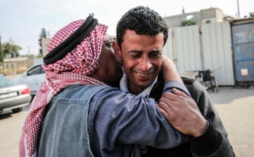 The father of a Palestinian teenager killed by Israeli forces during protests and clashes along the Gaza border cries outside a hospital in the blockaded enclave