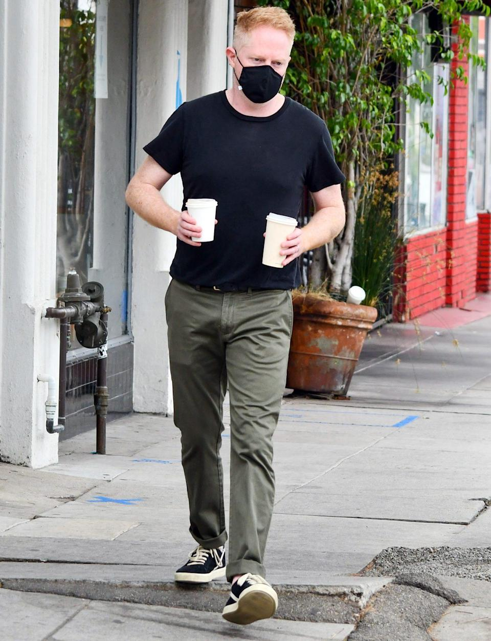 <p>Jesse Tyler Ferguson is seen fueling up on a coffee run on Friday in L.A. </p>
