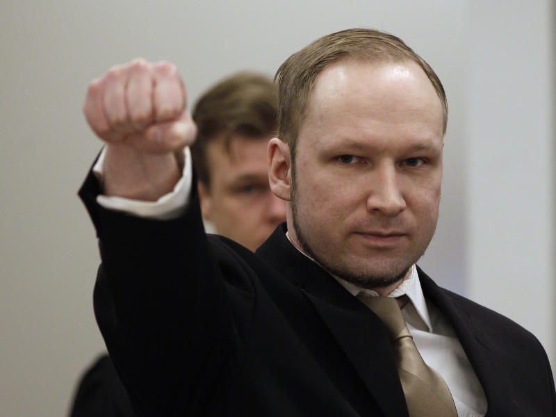 Norwegian Anders Behring Breivik gestures as he arrives at a courtroom, to face terrorism and premeditated murder charges, Oslo, Norway, Monday, April 16, 2012. Breivik, who confessed to killing 77 people in a bomb-and-shooting massacre went on trial in Norway's capital Monday, defiantly rejecting the authority of the court. (AP Photo/Frank Augstein)