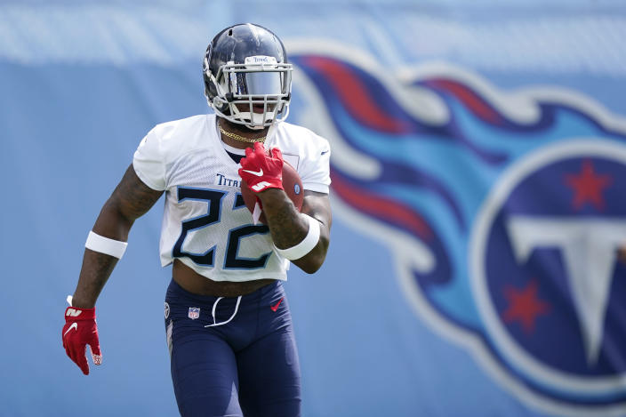 Tennessee Titans running back Derrick Henry looks for his second straight NFL rushing title this season. (AP Photo/Mark Humphrey)
