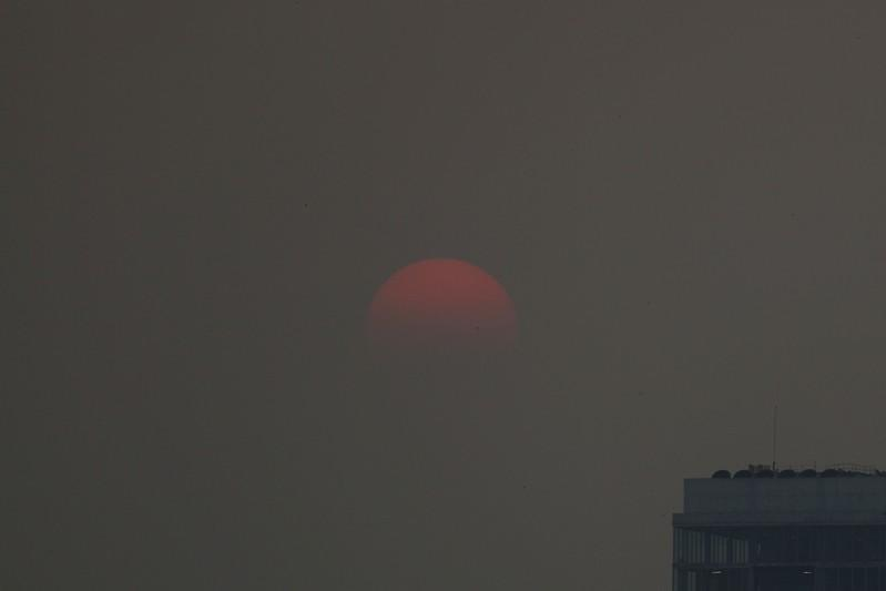 FILE PHOTO: The sunset is seen during a poor air quality day in Bangkok