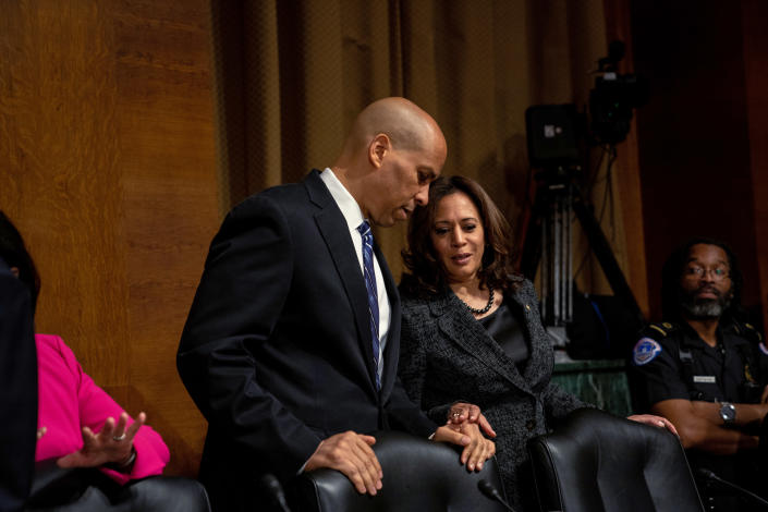 Sens. Cory Booker (D-N.J.) and Kamala Harris (D-Calif.) confer during the Senate confirmation hearing for Supreme Court nominee Brett Kavanaugh in Washington on Sept. 27, 2018. (Erin Schaff/The New York Times)