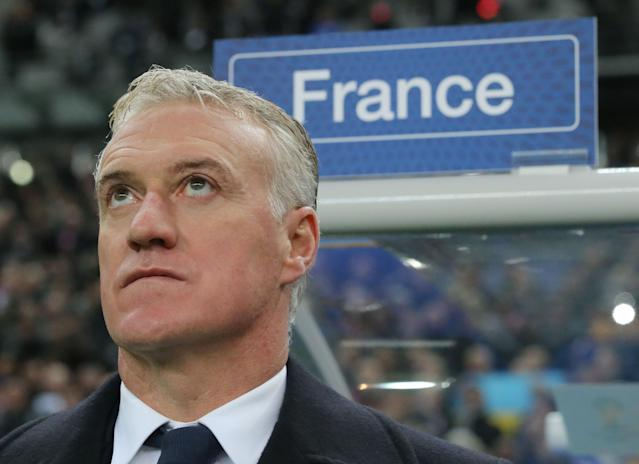 FILE - In this Nov. 19, 2013, file photo, Didier Deschamps, coach of the French soccer team pays attention to a national anthem during a World Cup qualifying playoff second-leg soccer match France against Ukraine at Stade de France stadium in Saint Denis, outside Paris. The French production line continues to turn out some of the most sought-after talents in the world game, but following in the footsteps of the 1998 world champions and 2006 runners-up has proved no easy task. Typically cited as among the favourites ahead of any major tournament, Les Bleus failed to win a single game at either UEFA EURO 2008 or the 2010 FIFA World Cup, and took a laborious route through to the quarter-finals at EURO 2012. (AP Photo/Michel Euler, File)