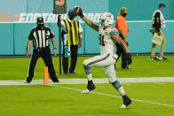 Miami Dolphins tight end Durham Smythe (81) gestures after scoring a touchdown during the second half of an NFL football game against the Los Angeles Chargers, Sunday, Nov. 15, 2020, in Miami Gardens, Fla. (AP Photo/Lynne Sladky)