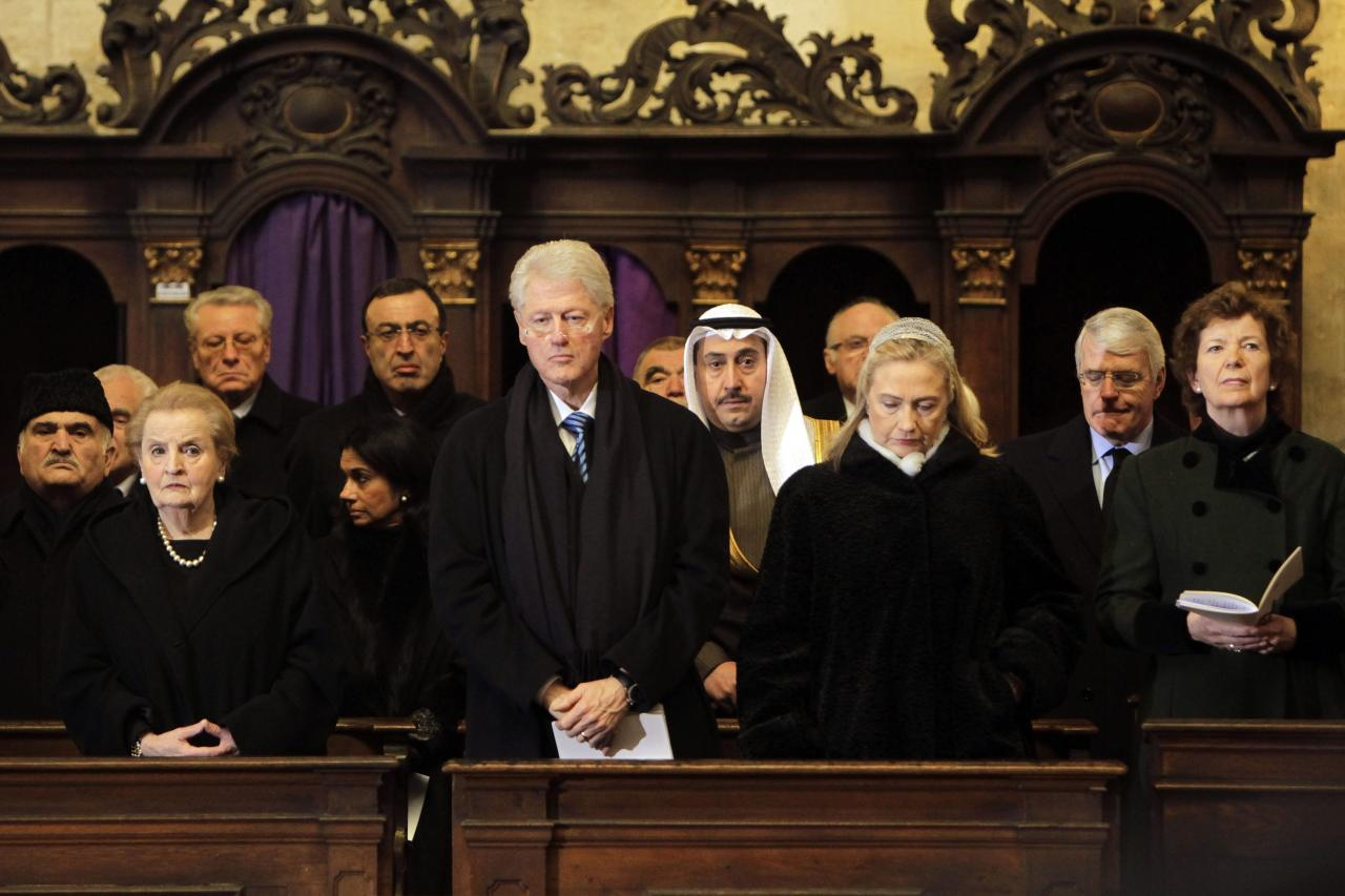 "Former US Secretary of State Madeleine Albright, former US President Bill Clinton and US Secretary of State Hillary R. Clinton, from left, attend the state funeral of former Czech President Vaclav Havel in the St. Vitus Cathedral in Prague, Friday, Dec. 23, 2011. Havel was the leader of the peaceful anti-communist ""Velvet Revolution."" He died Sunday, Dec. 18, at age 75. (AP Photo/Markus Schreiber)"