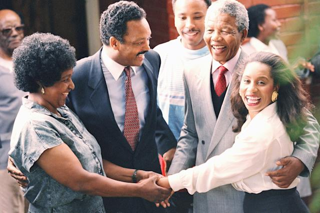 <p>Former U.S. presidential candidate Jesse Jackson, second from left, and Nelson Mandela, second from right, look on as their wives, Winnie Mandela, left, and Jacqueline Jackson hold hands when the Jacksons visited he Mandelas' Soweto home in South Africa on Feb. 15, 1990. Mandela was released from prison on Feb. 2, 1990, after serving over 27 years. (Photo: Greg English/AP) </p>