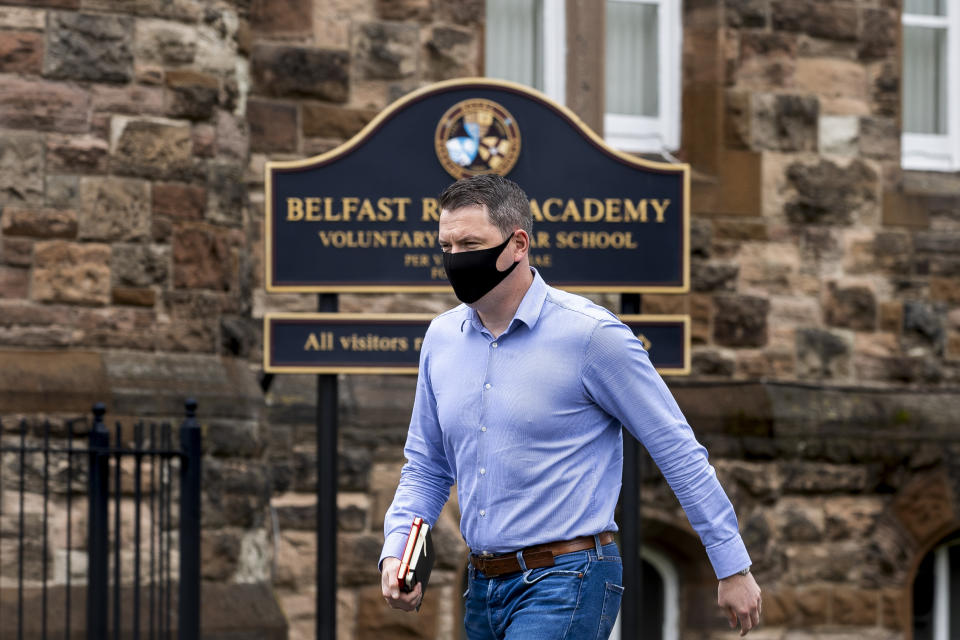 John Finucane MP for north Belfast outside Belfast Royal Academy in Northern Ireland after visiting the school. The grammar school contacted parents by email to advise that it is making it mandatory for pupils and staff to wear face coverings when they return to school. (Photo by Liam McBurney/PA Images via Getty Images)