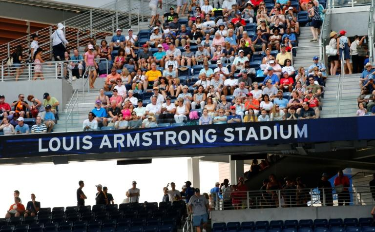 One and done: Fans in the new Louis Armstrong Stadium see Kaia Kanepi topple number one seed Simona Halep in the US Open first round