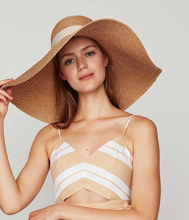 Oversize hat with cream ribbon. (Photo: Express)