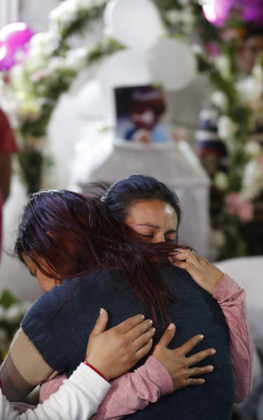 Relatives of Fatima, a 7-year-old girl who was abducted from the entrance of the Enrique C. Rebsamen primary school and later killed, embrace during the girl's wake at their home in Mexico City, Monday, Feb. 17, 2020. Fatima's body was found wrapped in a bag and abandoned in a rural area on Saturday and was identified by genetic testing. (AP Photo/Marco Ugarte)
