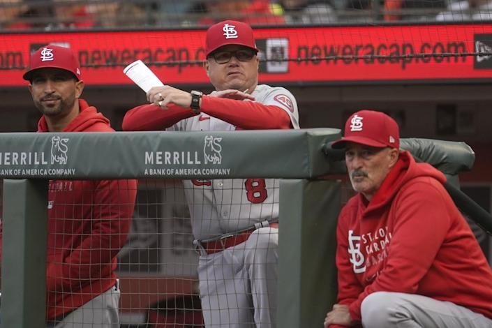 St. Louis Cardinals manager Mike Shildt, middle, watches from the dugout.