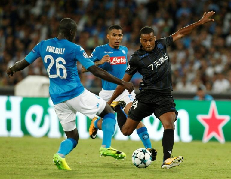 Nice's forward Alassane Plea (R) kicks the ball next to Napoli's defender Kalidou Koulibaly (L) and Napoli's defender Faouzi Ghoulam (C) during the UEFA Champions League Play Off first leg football match August 16 2017