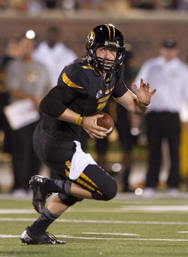 FILE - In this Aug. 31, 2013, file photo, Missouri quarterback Maty Mauk looks for a receiver during the fourth quarter of an NCAA college football game against Murray State in Columbia, Mo. Mauk will be the Tigers' starting quarterback when they face Florida this weekend. (AP Photo/L.G. Patterson, File)
