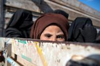 The sunken eyes beneath the headscarf attest to the appalling hardships the women and children have endured in the Islamic State group's last holdout before and during their escape